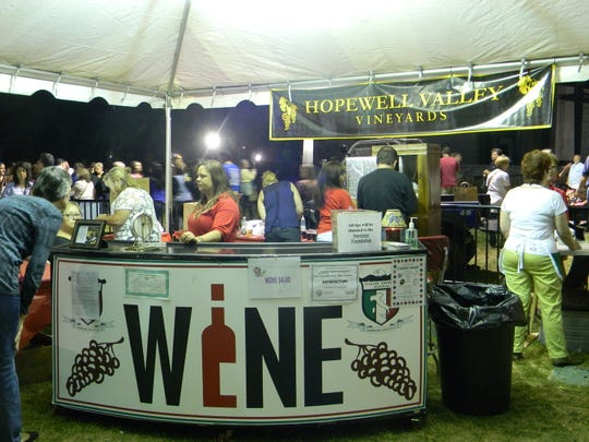 Visitors enjoy the wine  and beer garden at last year's Mercer County Italian-American erstival that is returning to Mercer County Park in West Windsor this year on Sept 27-29.