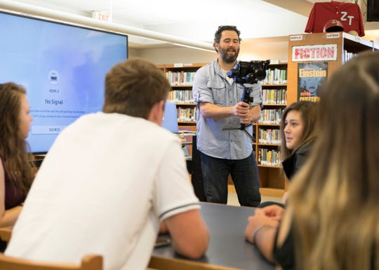 """Evan Shaw demonstrates a camera gimbal and how it helps to keep video steady to a group of journalism students at Zane Trace High School on Sept. 17, 2019. Shaw is a filmmaker with WOUB in Athens  and is known for his work with the NFL and """"Our Town"""" series of documentaries."""