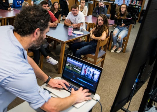Evan Shaw shows students how many digital elements are a part of editing a video project, which includes the video, voice over, and music at Zane Trace High School Tuesday morning.