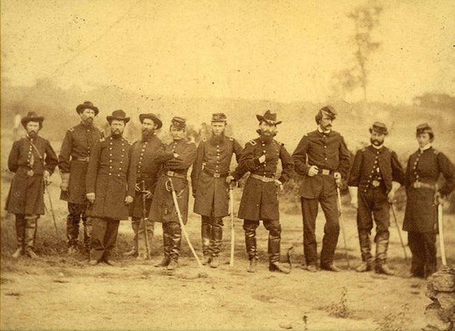 Brigadier General William Haines Lytle, fourth from right, with his hand placed inside his coat, with his Union Army staff in the field.