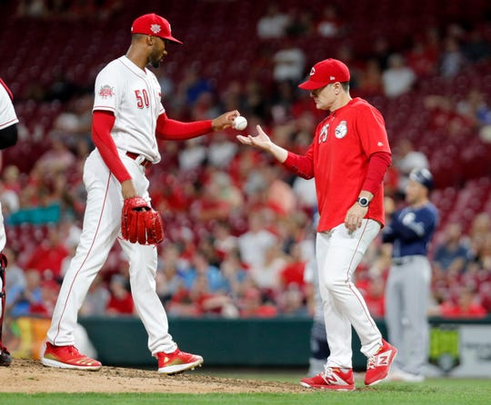 Aug 20, 2019; Cincinnati, OH, USA; Cincinnati Reds manager David Bell (25) takes the ball from relief pitcher Amir Garrett during the eighth inning against the San Diego Padres at Great American Ball Park. Mandatory Credit: David Kohl-USA TODAY Sports