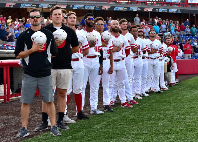 Players from the Florence Freedom acknowledge the flag of the United States of America as the National Anthem is played prior to game 5 of the Frontier League Championship at UC Health Stadium in Florence, KY, September 16, 2019.