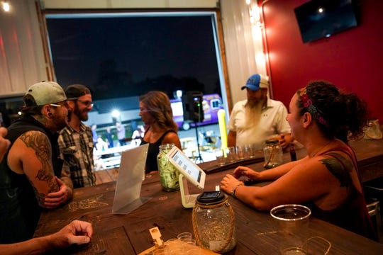 Patrons and bartenders chat at Gladiator Brewing Co. in Clarksville, Tenn., on Saturday, Sept. 14, 2019.