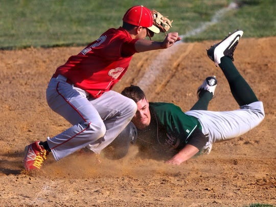 Joe Weaver slides safely into third base as Edison's Justin Hernandez applies the tag during a game on April 6, 2016