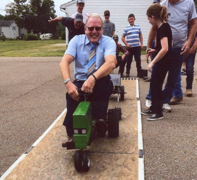 Pastor Dan Eggan of Fresno United Methodist Church participates in a pedal tractor pull during Rural Life Sunday event, held annually by the congregation to celebrate farming and agriculture.