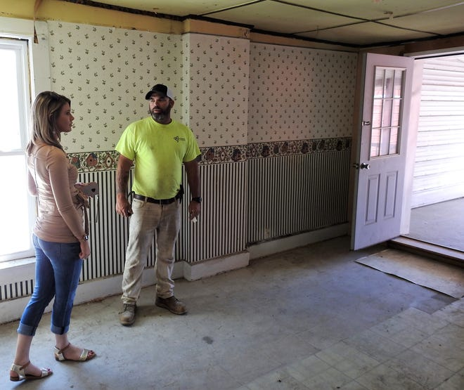 Carly and Jason Thompson review a former apartment at the structure spanning 527 and 531 Main St. The couple under their business Grason Properties bought the buildings at an auditor's sale in May and are working on renovations with a focus on bringing in new businesses to downtown.