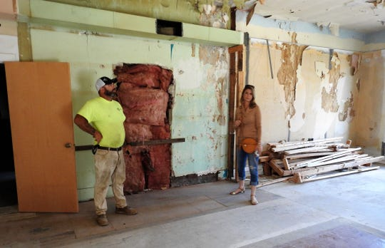 Carly and Jason Thompson review a former apartment at the structure spanning 527 and 531 Main St., a property they purchased in May.