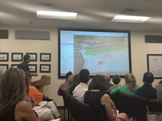 Mark Lee presents a mock up of a proposed site for a mining operation in Booneville in Dallas County at the Dallas County Planning and Zoning Commission meeting on Tuesday, Sept. 17, 2019.