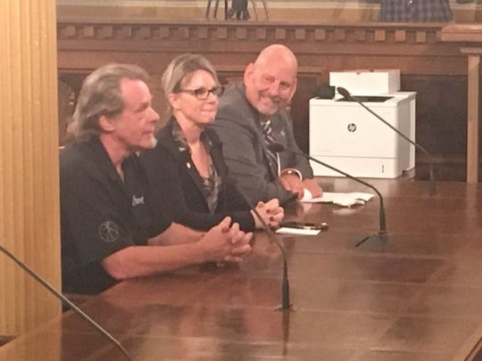 Controversial and conservative rock musician Ted Nugent testified in Lansing  about a bill that would allow baiting of deer during hunting season Tuesday, Sept. 19, 2019. He is sitting with Rep. Michele Hoitenga, R-Manton, who sponsored the bill, and Sen. Curt VanderWall, R-Ludington, who sponsored a similar bill in the state Senate.