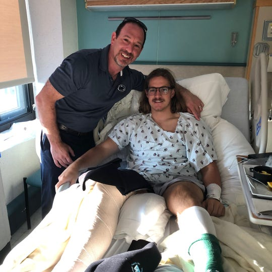 Dr. Dov Bader, right, performed surgery on Buffalo punter Evan Finegan after he suffered a Joe Theismann-like broken leg against Penn State.