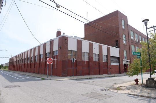 A block-long vacant building on Hobson at Noble Street.