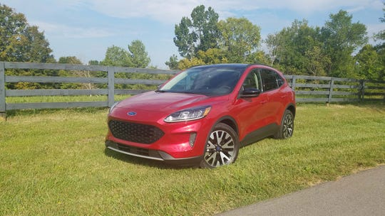 The 2020 Ford Escape Sport Hybrid comes with blacked-out grille and windows, a digital instrument cluster and 198 horsepower.
