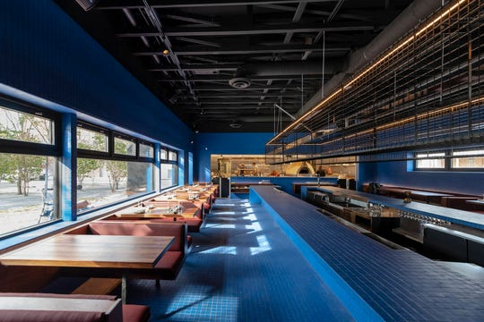 The dining room of Magnet has a view of a courtyard and a sunken bar in the center.