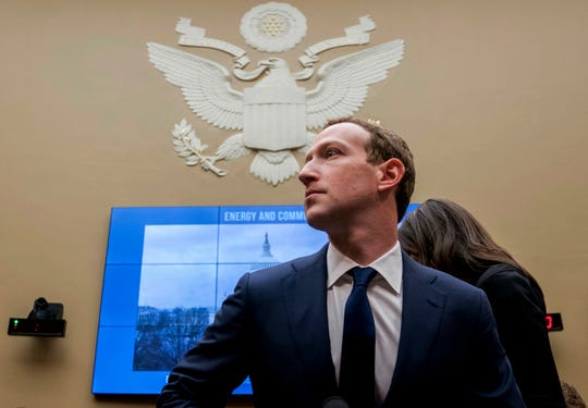 FILE - In this April 11, 2018, file photo, Facebook CEO Mark Zuckerberg arrives to testify before a House Energy and Commerce hearing on Capitol Hill in Washington. Facebook said Tuesday, Sept. 17, 2019, that it expects to name the first members of a new quasi-independent oversight board by year-end. The oversight panel, which the social network first discussed publicly last November, will rule on thorny content issues, such as when Facebook or Instagram posts constitute hate speech.