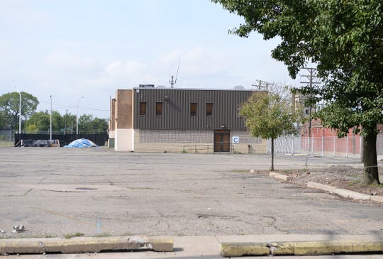 A empty lot with the former Michigan Consolidated gas company in the background on Noble Street.
