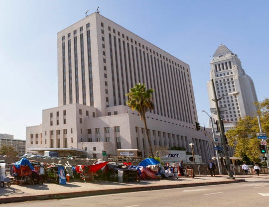 Homeless camp in tents downtown Los Angeles Tuesday, Sept. 17, 2019. Donald Trump said he wants to curb homelessness in Los Angeles and other large U.S. cities, blaming the problem squarely on Democrats as he campaigns for re-election.