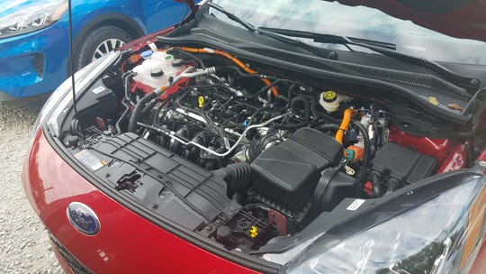Under the hood in the 2020 Ford Escape Sport Hybrid.