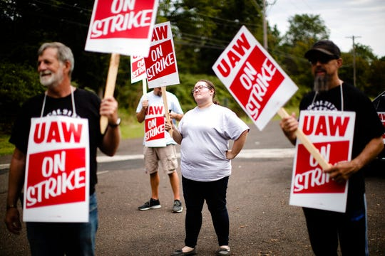 Kelly McKinnon and other workers and their supporters demonstrative outside a General Motors facility in Langhorne, Pa., Monday, Sept. 16, 2019.