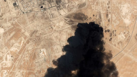 In this Saturday, Sept. 14, 2019 file photo, a satellite image from Planet Labs Inc. shows thick black smoke rising from Saudi Aramco's Abqaiq oil processing facility in Buqyaq, Saudi Arabia.