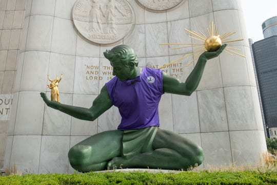 The city of Detroit dressed up the Spirit of Detroit statue in a purple shirt and bowtie Tuesday morning in honor of the Detroit Youth Choir, who are finalists on America's Got Talent and will perform tonight.