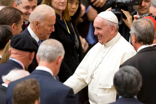 In this April 29, 2016, file photo, Vice President Joe Biden shakes hands with Pope Francis during a congress on the progress of regenerative medicine held at the Vatican. Biden has demonstrated a deep public connection to his Catholic faith, dating to the earliest days of his political career.