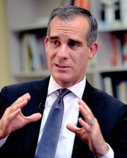In this Aug. 16, 2018 file photo, Los Angeles Mayor Eric Garcetti talks during an interview about homelessness in Los Angeles. Garcetti says he hopes President Donald Trump will work with the city to end homelessness.
