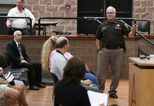 The Lenawee County Undersheriff answers questions during a fact finding meeting at Addison High School on Monday, Sept. 9, 2019 to explore whether staff at the school should be allowed to carry guns. A timeline for a decision on the proposal has not been determined.
