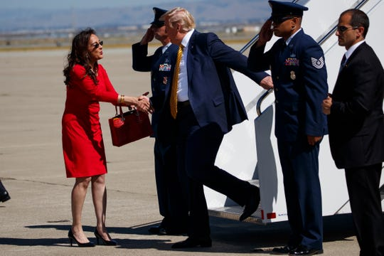 President Donald Trump is greeted by Republican National Committeewoman from California Harmeet Dhillon as he arrives at Moffett Federal Airfield to attend a fundraiser, Tuesday, Sept. 17, 2019, in Mountain View, Calif.