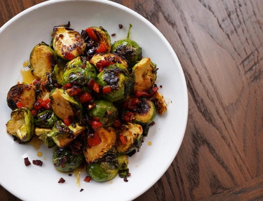A new Brussels sprouts appetizer with red pepper and country ham from Hometown Roots.