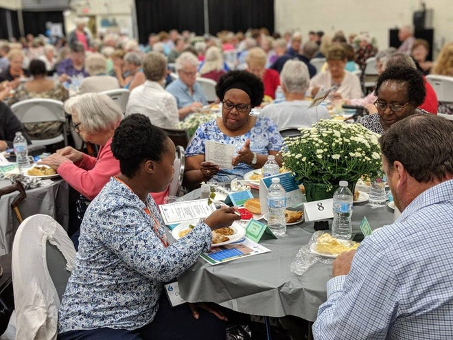 Guests take in a meal during the grand opening of the Great Lakes Community Action Partnership Senior Center.