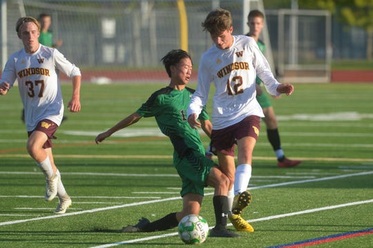 A Windsor soccer player makes a pass during Fossil Ridge's 2-1 win at home on Monday, Sept. 16, 2019.