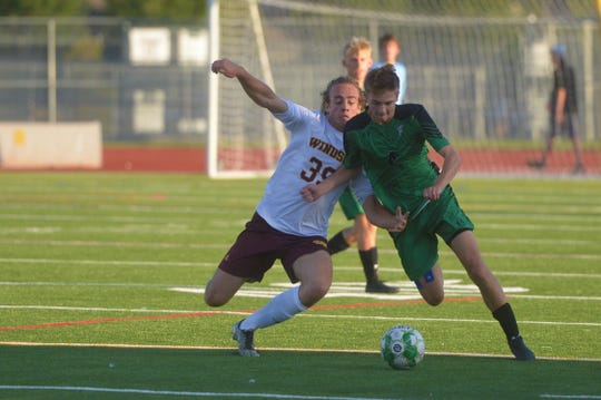 Fossil Ridge High School boys soccer player Drew Bohl dribbles past a Windsor defender during a Sept. 16, 2019, game. Fossil Ridge faces cross-town rival Rocky Mountain at 6:15 p.m. Wednesday at French Field.