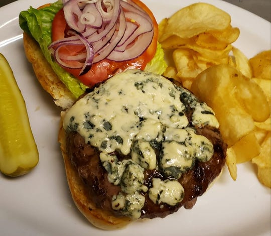 The Black and Bleu Burger from Kenwood Lane Grille in south Fort Myers is made with blue cheese melted atop a house-ground patty.