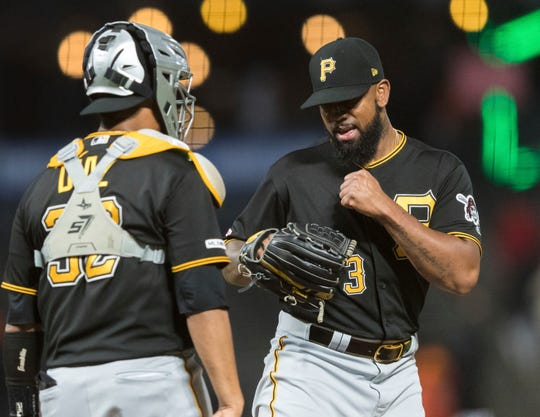 Pittsburgh Pirates relief pitcher Felipe Vazquez, right, celebrates with catcher Elias Diaz after defeating the San Francisco Giants a baseball game in San Francisco, Monday Sept. 9, 2019. (AP Photo/John Hefti)