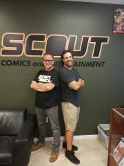 """""""Solar Flare"""" creator James Haick (right) and comic-book writer Scott Lobdell pose at the Fort Myers headquarters of Scout Comics."""