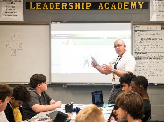 First Sgt. Esteban Jaramillo, a Mariner High School JROTC teacher, gestures in front of a freshman JROTC class on Tuesday, Sept. 17, 2019. The U.S. Army Cadet Command chose Mariner High School for a pilot program that institutes more technology among other amenities into the curriculum.