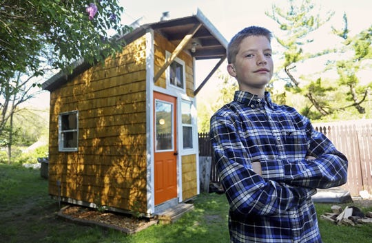 Nicki Kohl /Telegraph Herald via AP  Luke Thill, 13, of Dubuque, Iowa, says he?s gained some construction skills, but also learned a lot about financing and project management while building a tiny house in his back yard. In this Tuesday, May 2, 2017 photo, Luke Thill, of Dubuque, Iowa, a seventh-grader at Thomas Jefferson Middle School in Dubuque, Iowa, poses near a tiny house he built. (Nicki Kohl /Telegraph Herald via AP)
