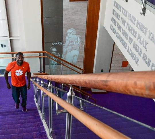 "Former Clemson football player Ramon ""Ray Ray"" McElrathbey walks up the stairs to the Paw Journey Center in the Allen Reeves football complex in Clemson Tuesday, September 17, 2019."