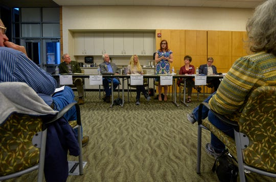 Great Falls City Council candidates respond to questions during a forum on Monday night at Great Falls Clinic Specialty Center. Mayor Bob Kelly, far left, who is running unopposed sits with city commission candidates, from left to right: Bruce Pollington, Kim Rodriguez, Jasmine Taylor (standing), Terry Thompson and Rick Tryon.