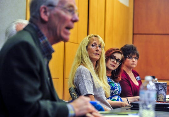Great Falls City Council candidates take questions during a forum on Monday night at Great Falls Clinic Specialty Center.  Candidates Kim Rodriguez, left, Jasmine Taylor, center, and Terry Thompson listen to Mayor Bob Kelly's response during the forum.