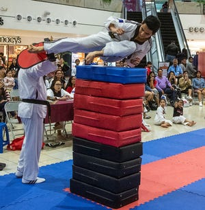 4th degree blackbelt Jed Caluag clears 9 foam shields to claim the gold medal in the men's division during the 8th Annual Master Noly's Flying Side Kick Tournament, held Sept. 15 at the Micronesia Mall.
