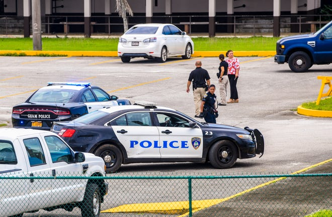 Emergency personnel from the Guam Police Department and Guam Fire Department work with school staff members as they monitor Tiyan High School after a riot was reported at the Barrigada campus on Tuesday, Sept. 17, 2019. Students were release from classes early on that day. Seven minors were treated for injuries relating to the disturbance, according to Lt. Kevin Reilly, GFD spokesman. Three of the minors injured, were transported to the hospital.