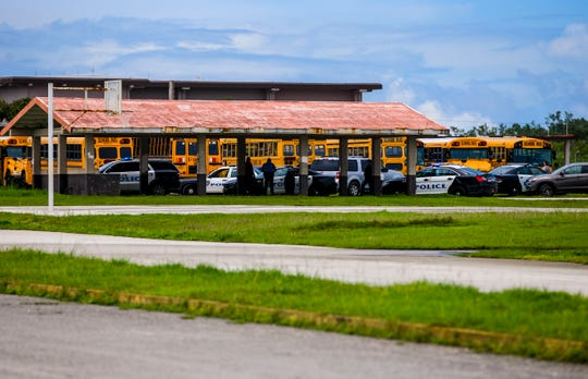 In this Sept. 17, 2019 file photo, emergency personnel from the Guam Police Department and Guam Fire Department monitors Tiyan High School after responding to a riot reported at the Barrigada campus that day. The campus was on shelter-in-place again on Sept. 26, 2019.
