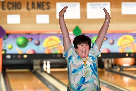 Connie O'Leary celebrates a great frame at Echo Lanes Monday on the opening day of the 2019 Henderson Senior Games.