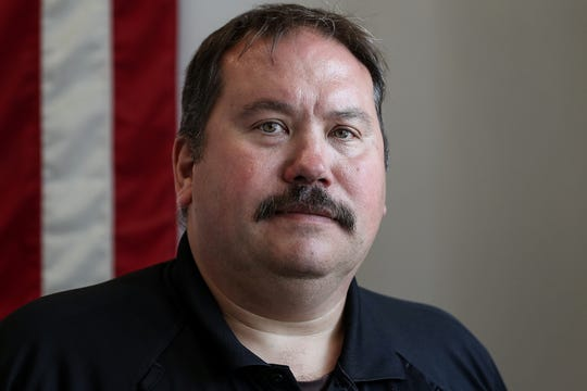 "Indianapolis Metropolitan Police Department officer Ethan McGivern poses for a portrait at IMPD southeast district in Indianapolis, Thursday, Sept. 12, 2019. McGivern, 49, has worked as a patrol officer and undercover narcotics officers, and now works on IMPD's behavioral health unit. The unit launched four years ago to help residents whose run-ins with police are often caused by mental health problems. ""I can tell you that 9.9 times out of 10, when I run in with a client,"" McGivern said, ""even if they're in a violent mode or something like that, de-escalation techniques and stuff like that almost always work."""