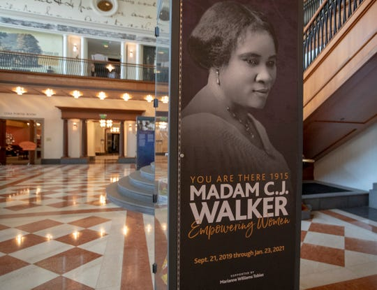 An exhibit at the Indiana Historical Society features artifacts and re-enactors portraying Madam C.J. Walker. Before she died in 1919, the African American activist and entrepreneur created a line of cosmetics and hair care products.