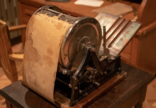 A lithograph machine, for making copies, is part of an exhibit at the Indiana Historical Society featuring artifacts and re-enactors portraying Madam C.J. Walker. The African American activist and entrepreneur, who died in 1919, created a line of cosmetics and hair care products.