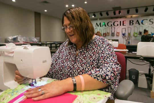 Resident Kimberly Kingsbury uses a sewing machine to make a Maggie Bag, Tuesday, Aug. 27, 2019, at the Maggie Bags store and warehouse in Martinsville, Ind. More than 2,000 bags have been sold at various stores around Indiana and shipped across the country.