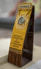 A pin that was worn by a Walker company representative will be on display at an exhibit at the Indiana Historical Society featuring artifacts and re-enactors portraying Madam C.J. Walker. The African American activist and entrepreneur, who died in 1919, created a line of cosmetics and hair care products.