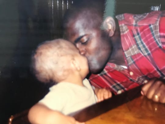 Notre Dame tight end Tommy Tremble, who weighed 30 pounds at age 1, gives father Greg Tremble a kiss